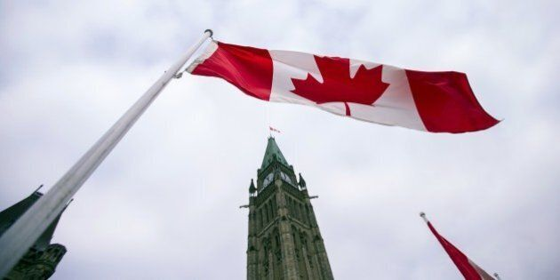 A Canadian flag flies in front of the peace tower on Parliament Hill in Ottawa, Canada on December 4,...