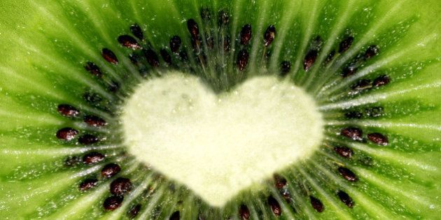 Macro section of kiwi shaped heart with vivid