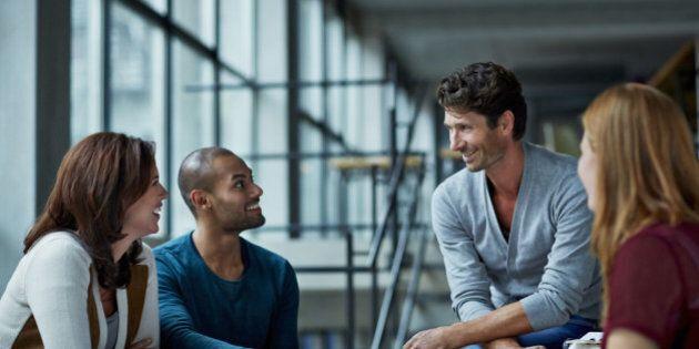 Coworkers in casual meeting in modern