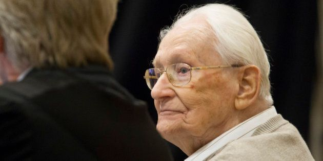 LUNEBURG, GERMANY - 21 APRIL:  Oskar Groening, 93, arrives for the first day of his trial to face charges of being accomplice to the murder of 300,000 people at the Auschwitz concentration camp on April 21, 2015 in Lueneburg, Germany. Groening was an accountant with the Waffen SS and has been open about his role, claiming in interviews with media that he accepts his moral responsibility. Groening has also written an account of his experience, in what he claims is an effort to counter Holocaust revisionists. State prosecutors accuse Groening of accomplice in the murder of 300,000 Hungarian Jews who arrived at Auschwitz in 1944.  (Photo by Andreas Tamme - Pool/Getty Images)