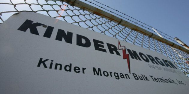 UNITED STATES - AUGUST 28: A sign hangs from a fence at a Kinder Morgan facility at the harbor in Los...