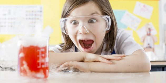 Schoolgirl (11-13) doing science experiment in school laboratory, Scientific Experiment,Safety,BeakerBrown Hair,Caucasian,Appearance,Chemistry,Chemistry Class,Liquid,Measuring, Laboratory, smoking, dry ice,Safety Glasses,chmistry,excitement