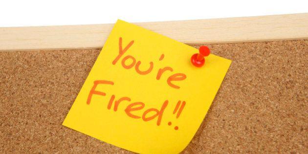 You're fired written on a post it note on a corkboard
