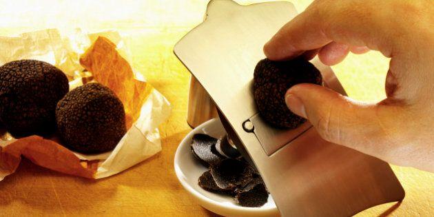 Black truffle being sliced