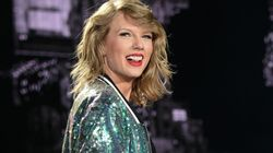 Taylor Swift Almost Pulled Down By Fans In