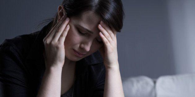Despair crying widow woman wearing mourning