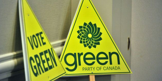 Green Pary signs are seen as Elizabeth May (out of frame), leader of the Green Party of Canada, addresses...
