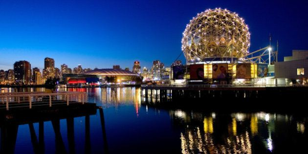 VANCOUVER, CANADA - FEBRUARY 18: The TELUS World of Science geodesic dome and the city skyline are reflected...