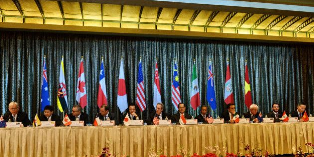 Trade ministers and representatives attend a press conference at the Trans-Pacific Partnership (TPP) ministerial meeting in Singapore on February 25, 2014. Asia Pacific trade ministers began a fresh round of talks in Singapore February 22 for a huge US-led Pacific free trade area, hoping to conclude a deal this year after missing a deadline in 2013. AFP PHOTO / ROSLAN RAHMAN        (Photo credit should read ROSLAN RAHMAN/AFP/Getty Images)