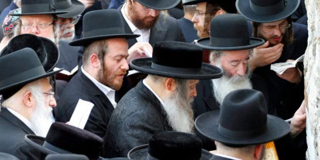 Ultra-orthodox Jews, members of the Satmar Hasidic Community from New York, pray at the grave of Rabbi...
