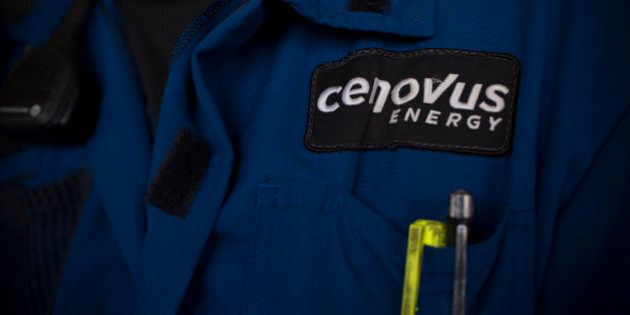 A Cenovus Energy Inc. logo is displayed on an employee's uniform at Christina Lake, a situ oil production...