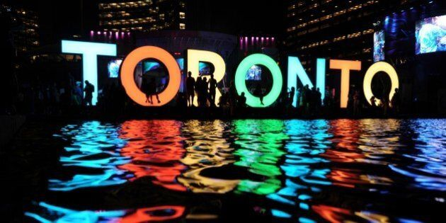The Toronto sign is seen at the Nathan Phillips Square as people watch a concert during 2015 Pan American...