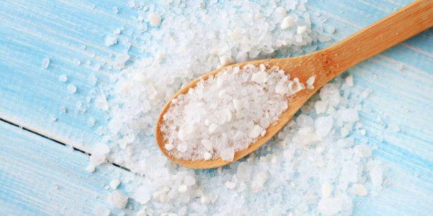 large grains of sea salt on shabby light blue