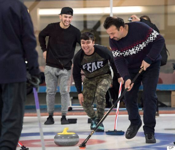 Lots Of Laughs (And Tumbles) As Refugees Learn Curling In