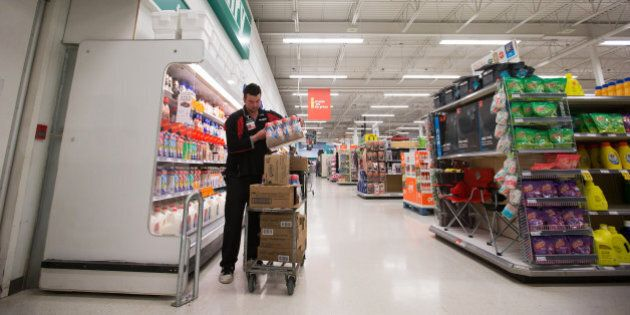 An employee restocks shelves at a grocery store in Lac La Biche, Alberta, Canada, on Saturday, May 7,...