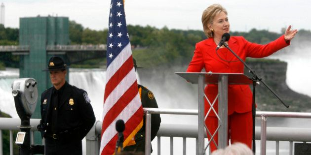 U.S. Secretary of State Hillary Rodham Clinton speaks in the center of the Rainbow Bridge which connects...