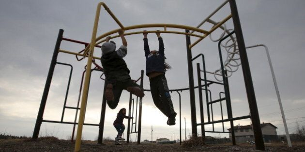 Children play in a playground in the Attawapiskat First Nation in northern Ontario, Canada, April 15,...