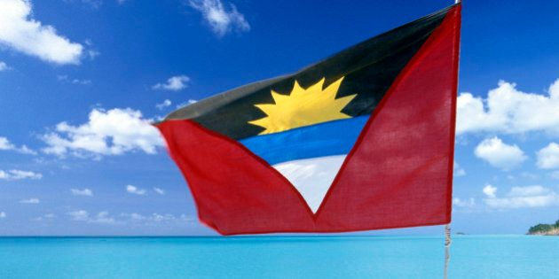 Antigua and Barbuda, Antigua Island, the national flag in red, white, blue and black, with the symbol...