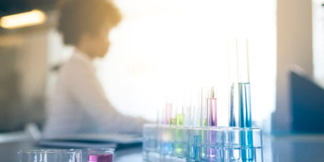 A young African American woman doing research in the laboratory and making