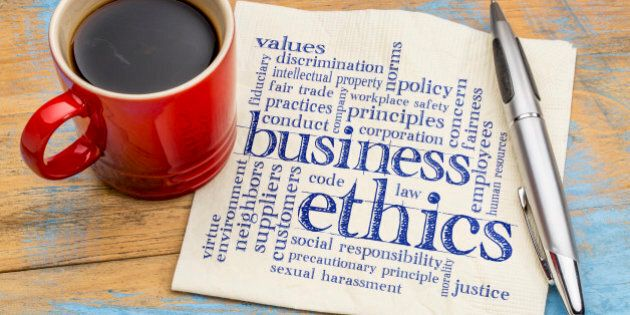 business ethics word cloud - handwriting on a napkin with cup of