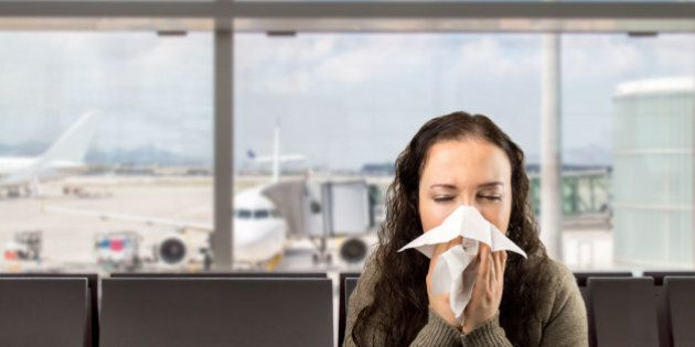 sneezing woman sick blowing nose with white