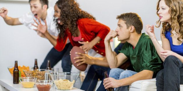 a group of young people watching football