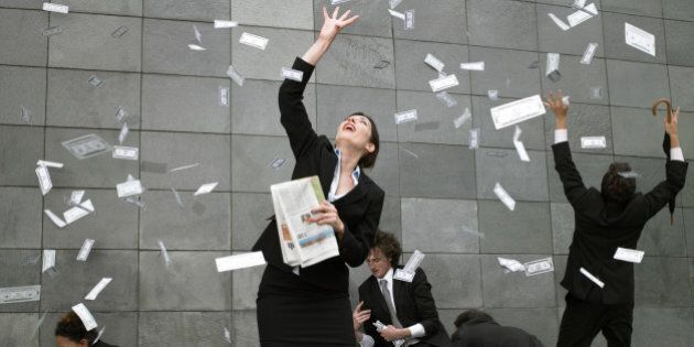 Business people on pavement catching falling