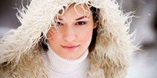 Young girl having fun in snow