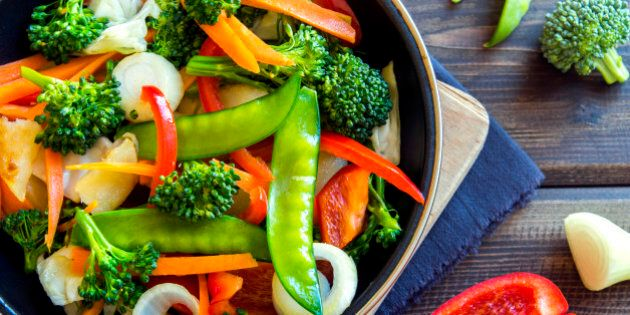 Healthy stir fried vegetables in the pan and ingredients close