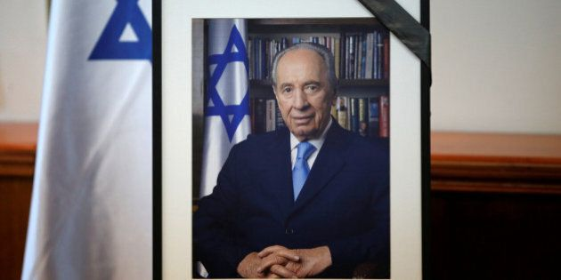 A photograph of former Israeli President Shimon Peres is displayed before the start of a special cabinet...