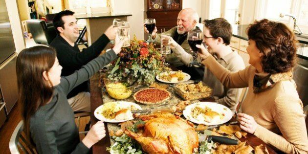 Family toasting at Thanksgiving meal