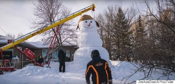 Manitoba Family Builds Snowman Taller Than Their