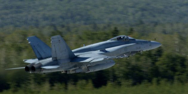 A CF-18 takes off from the Canadian Air Force base in Bagotville, Quebec. The Bagotville base is currently...