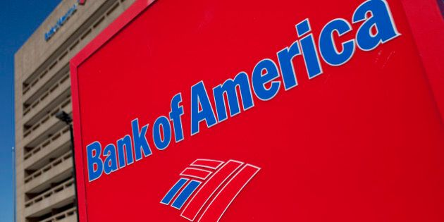 The Bank of America Corp. logo is displayed in front of a branch in Galveston, Texas, U.S., on Saturday, Oct. 1, 2011. Bank of America Corp. (BAC) should face fraud proceedings after its Countrywide unit submitted faulty data to back up claims for reimbursement on federally insured mortgages, according to an audit by a U.S. watchdog. Photographer: Scott Eells/Bloomberg via Getty Images