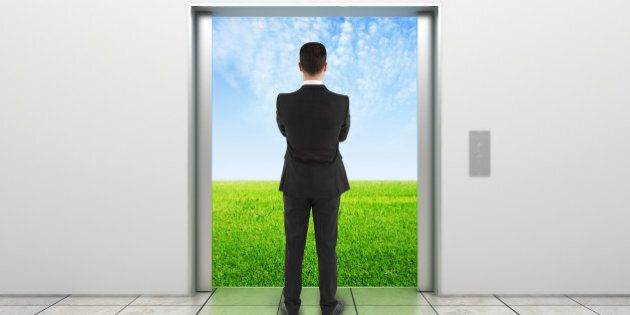 man and modern elevator with opened doors to field