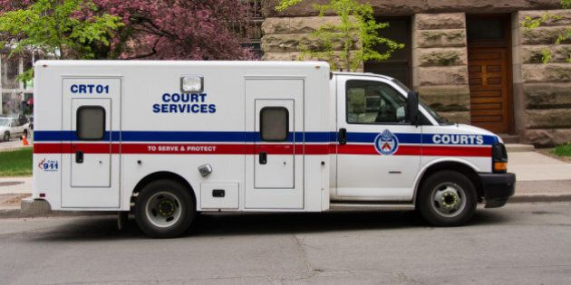 TORONTO, ONTARIO, CANADA - 2015/05/13: Toronto Court Services van. The white van has the words 'Court...