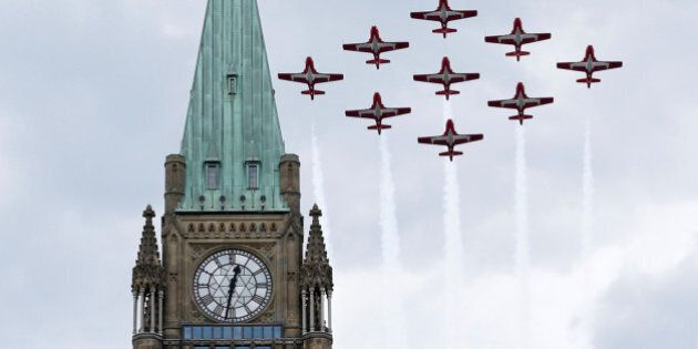 The Canadian Forces Snowbirds aerobatic team fly past the Peace Tower during Canada Day celebrations...