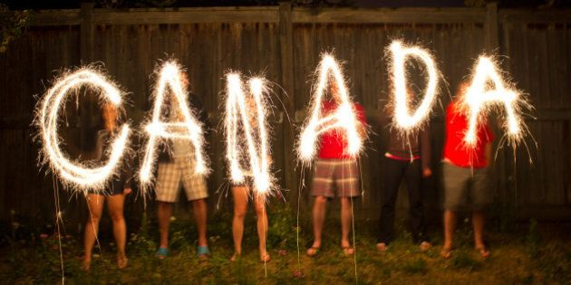 The word Canada in sparklers in time lapse photography as part of Canada Day (July 1)
