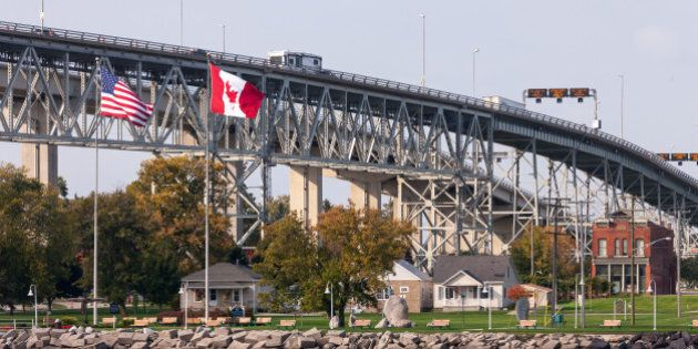 The Bluewater Bridge spanning the St. Clair River connects Sarnia Ontario, Canada, to Port Huron Michigan,