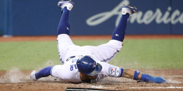 TORONTO, CANADA - SEPTEMBER 27: Kevin Pillar #11 of the Toronto Blue Jays slides across home plate to...
