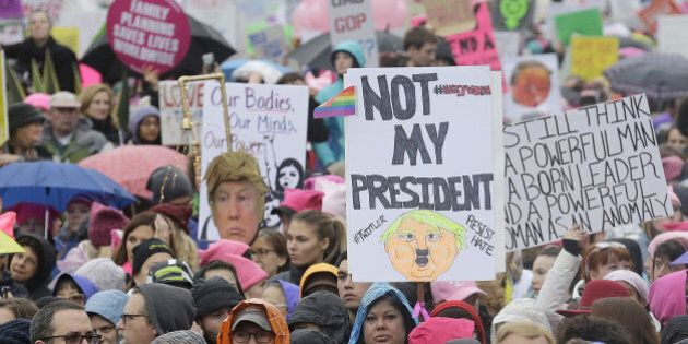 A crowd listens to speakers a rally before a women's march during the first full day of Donald Trump's presidency in San Francisco, Saturday, Jan. 21, 2017. (AP Photo/Jeff Chiu)