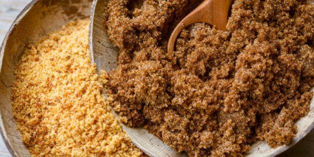 Soft brown dark sugar and unrefined sugar cane in