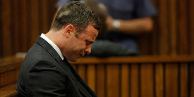 Oscar Pistorius cries in the dock in Pretoria, South Africa, Thursday, Sept. 11, 2014 as Judge Thokozile...