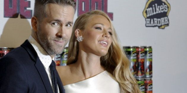 Actor Ryan Reynolds poses with his wife actress Blake Lively at the premiere of