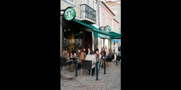 LISBON, PORTUGAL - DECEMBER 19: people having a break at Starbucks coffee esplanade on December 19, 2011...