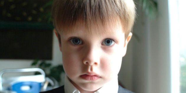 Canada, Toronto, Portrait of serious boy (8-9)