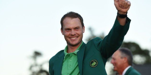 TOPSHOT - England's Danny Willett waves wearing his Green Jacket at the end of the 80th Masters Golf...
