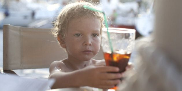 child drinking with a