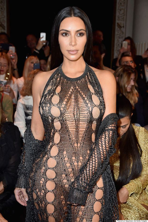 Kim Kardashian Wears See-Through Mesh Jumpsuit To Balmain Spring/Summer 2017