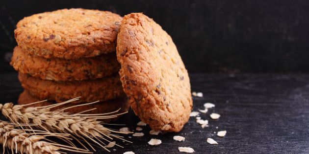 Oatmeal cookies with grains on a black background